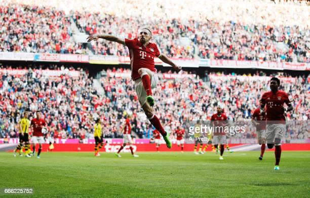 Franck Ribery of Bayern Muenchen celebrates scoring the opening goal during the Bundesliga match between Bayern Muenchen and Borussia Dortmund at...