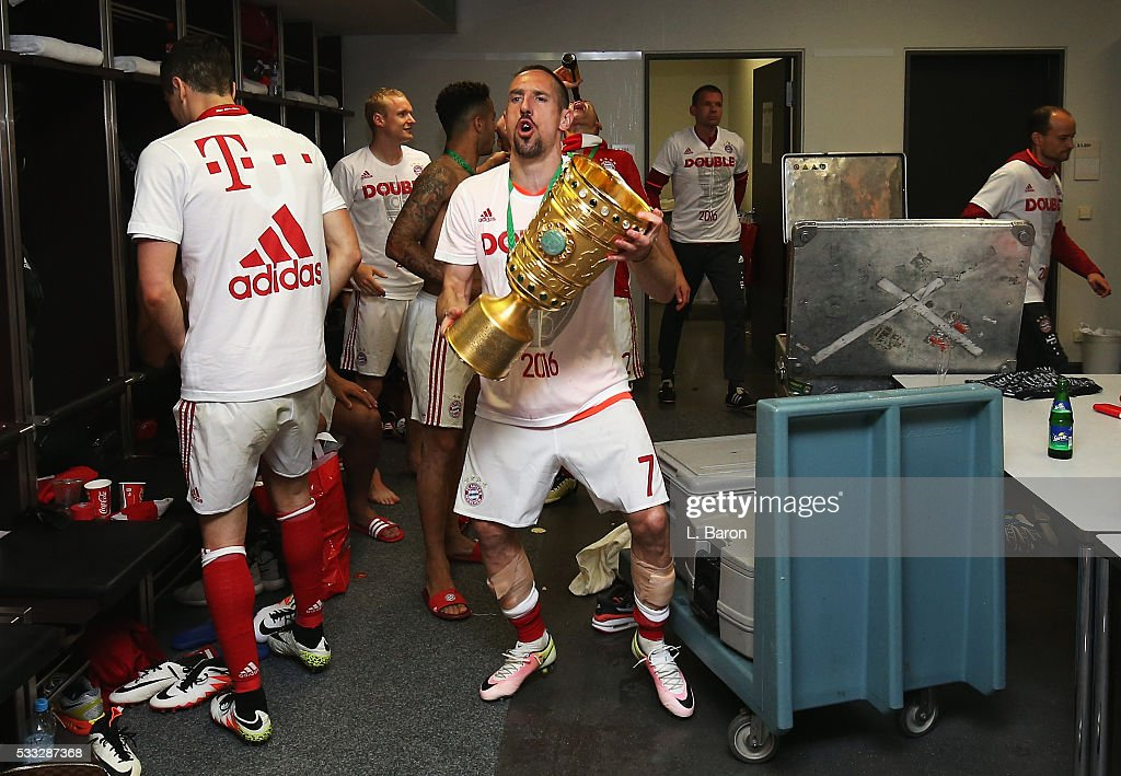 Franck Ribery of Bayern Muenchen celebrates victory with the trophy in the dressing room after the DFB Cup final match between FC Bayern Muenchen and Borussia Dortmund at Olympiastadion on May 21, 2016 in Berlin, Germany.