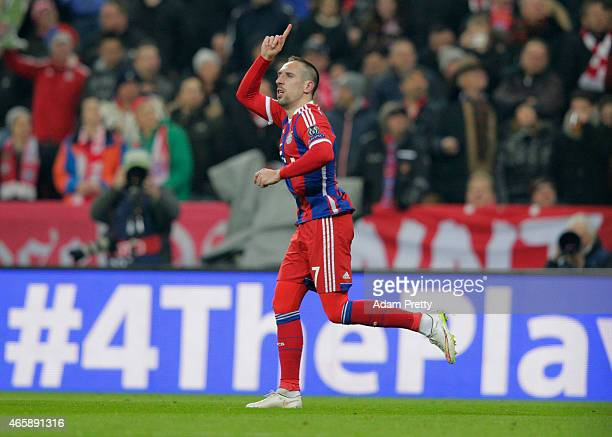 Franck Ribery of Bayern Muenchen celebrates with as he scores their third goal during the UEFA Champions League Round of 16 second leg match between...