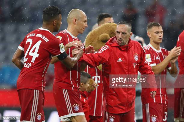 Franck Ribery of Bayern Muenchen celebrates with his team mate Corentin Tolisso after winning the Bundesliga match between FC Bayern Muenchen and...