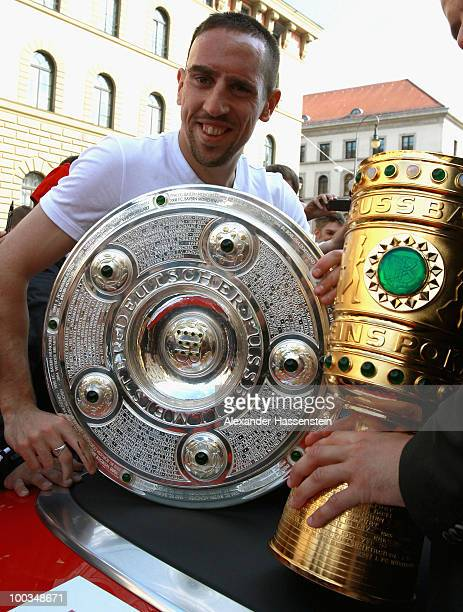 Franck Ribery of Bayern Muenchen celebrates with the German Championship Trophy and the German Cup Trophy on May 23 2010 in Munich Germany The team...