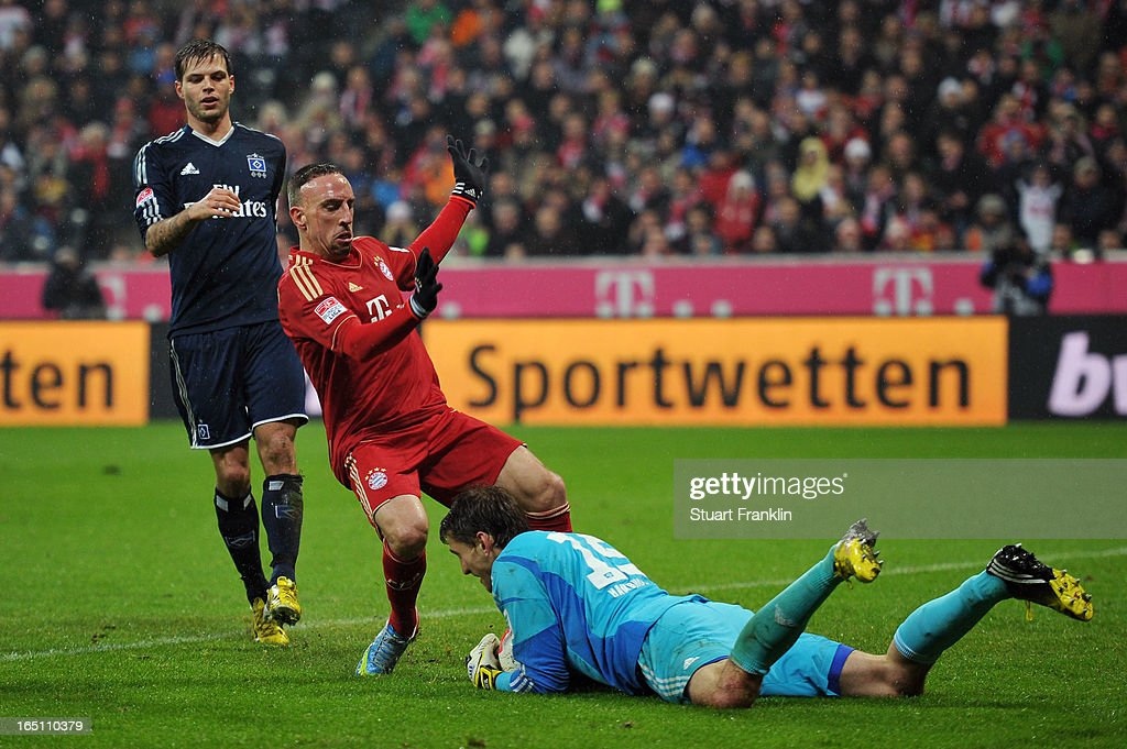 Franck Ribery of Bayern Muenchen challenges goalkeeper Rene Adler of Hamburger SV during the Bundesliga match between FC Bayern Muenchen and Hamburger SV at Allianz Arena on March 30, 2013 in Munich, Germany.