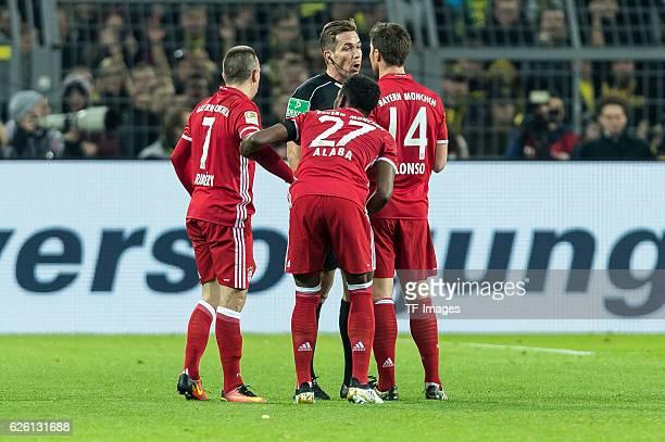 Franck Ribery of Bayern Muenchen David Alaba of Bayern Muenchen Xabi Alonso of Bayern Muenchen with discuss referee Tobias Stieler during the...