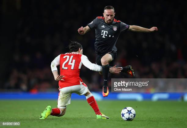 Franck Ribery of Bayern Muenchen evades Hector Bellerin of Arsenal during the UEFA Champions League Round of 16 second leg match between Arsenal FC...