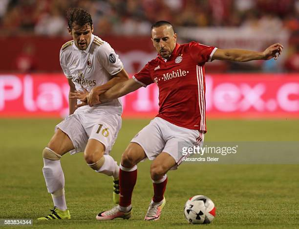 Franck Ribery of Bayern Muenchen fights for the ball with Andrea Poli of Milan during the International Champions Cup between FC Bayern Muenchen and...