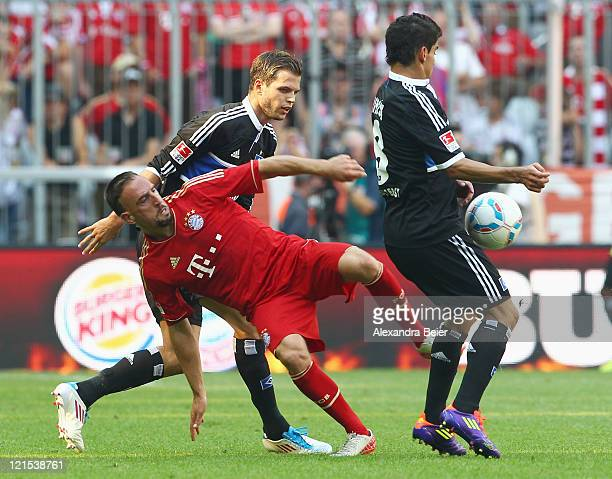Franck Ribery of Bayern Muenchen fights for the ball with Dennis Diekmeier and Tomas Rincon of Hamburg during the Bundesliga match between FC Bayern...