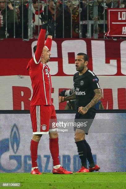Franck Ribery of Bayern Muenchen gestures and Dani Alves of Paris SaintGermain looks dejected during the UEFA Champions League group B match between...