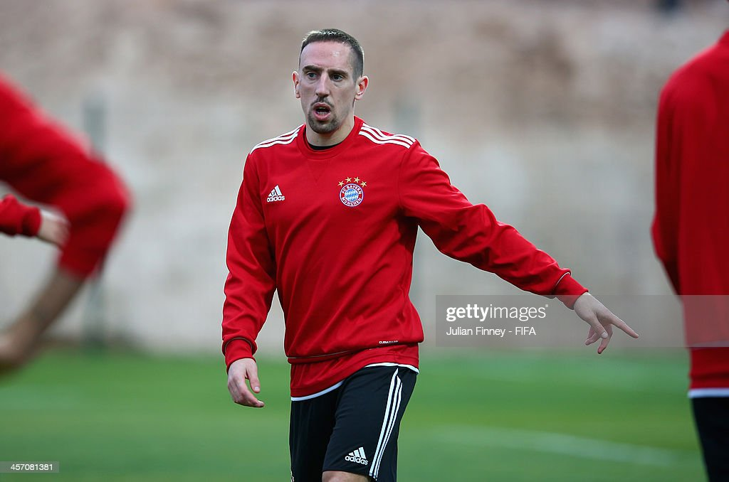 Franck Ribery of Bayern Muenchen gives instructions during a training session outside the Agadir Stadium on December 16, 2013 in Agadir, Morocco.