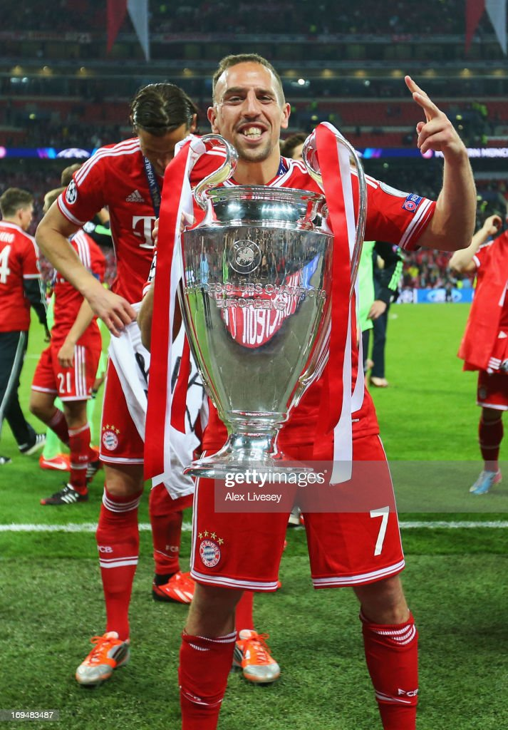 <a gi-track='captionPersonalityLinkClicked' href=/galleries/search?phrase=Franck+Ribery&family=editorial&specificpeople=490869 ng-click='$event.stopPropagation()'>Franck Ribery</a> of Bayern Muenchen holds the trophy after winning the UEFA Champions League final match against Borussia Dortmund at Wembley Stadium on May 25, 2013 in London, United Kingdom.