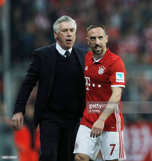 Franck Ribery of Bayern Muenchen is congratulated by Carlo Ancelotti head coach of Bayern Muenchen after being substituted during the Bundesliga...