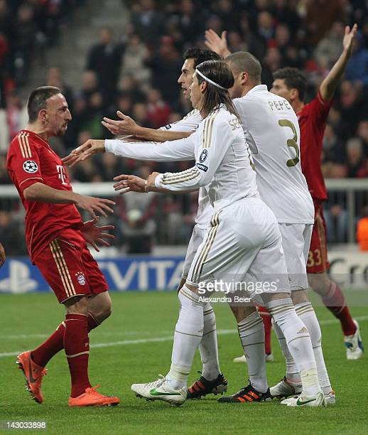 Franck Ribery of Bayern Muenchen is hustled by Alvaro Arbeloa Sergio Ramos and Pepe of Real Madrid during the UEFA Champoins League Semi Final first...