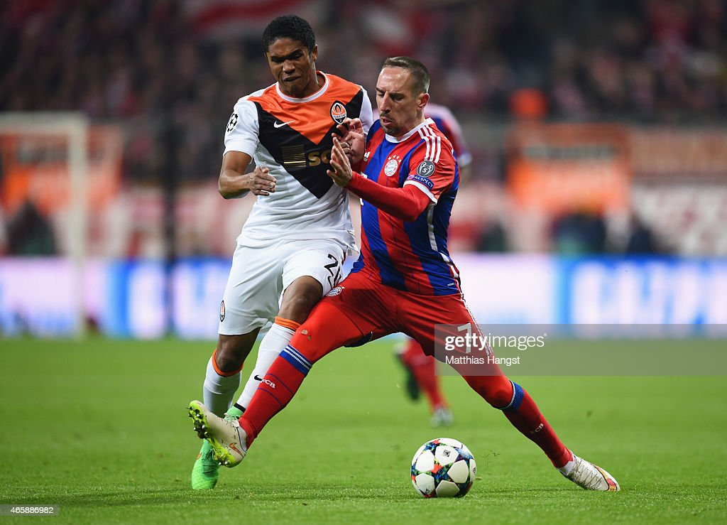 Franck Ribery of Bayern Muenchen is tackled by Douglas Costa of Shakhtar Donetsk during the UEFA Champions League Round of 16 second leg match...