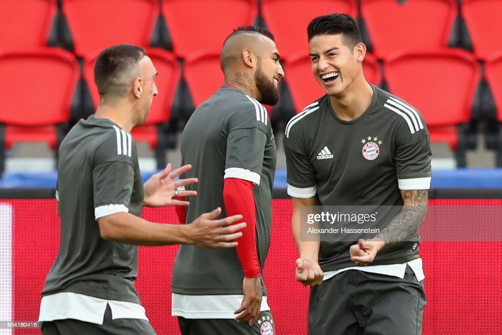 Franck Ribery (L) of Bayern Muenchen jokes with his team mates James Rodriquez (R) and Arturo Vidal during a training session ahead of the UEFA Champions League Group B match against Paris Saint Germain (PSG) at Parc des Princes on September 26, 2017 in Paris, France.