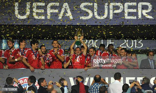 Franck Ribery of Bayern Muenchen lifts the trophy following the UEFA Super Cup match between Chelsea and Bayern Muenchen at Eden Stadium on August 30...