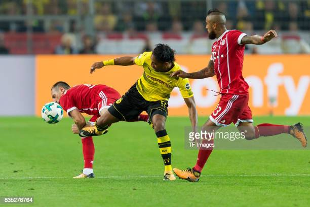 Franck Ribery of Bayern Muenchen PierreEmerick Aubameyang of Dortmund and Arturo Vidal of Bayern Muenchen battle for the ball during the DFL Supercup...