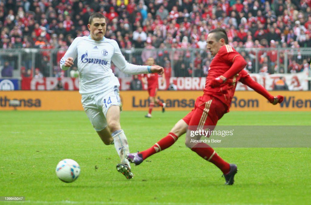 <a gi-track='captionPersonalityLinkClicked' href=/galleries/search?phrase=Franck+Ribery&family=editorial&specificpeople=490869 ng-click='$event.stopPropagation()'>Franck Ribery</a> (R) of Bayern Muenchen scores his first goal against <a gi-track='captionPersonalityLinkClicked' href=/galleries/search?phrase=Kyriakos+Papadopoulos&family=editorial&specificpeople=5446261 ng-click='$event.stopPropagation()'>Kyriakos Papadopoulos</a> of Schalke during the Bundesliga match between FC Bayern Muenchen and FC Schalke 04 at Allianz Arena on February 26, 2012 in Munich, Germany.