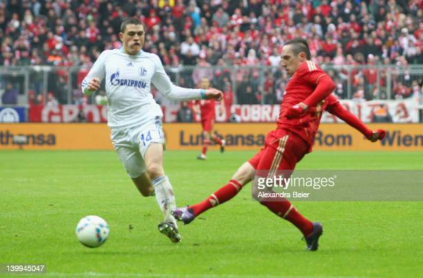 Franck Ribery of Bayern Muenchen scores his first goal against Kyriakos Papadopoulos of Schalke during the Bundesliga match between FC Bayern...