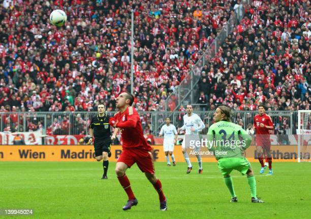 Franck Ribery of Bayern Muenchen scores his first goal against goalkeeper Timo Hildebrand of Schalke during the Bundesliga match between FC Bayern...