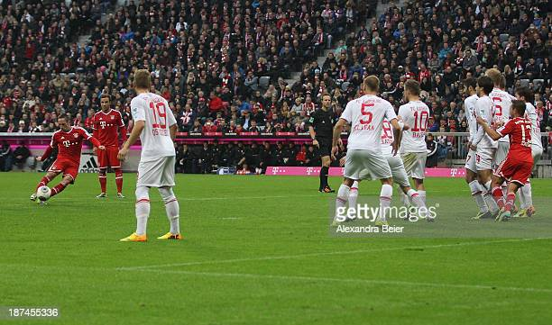 Franck Ribery of Bayern Muenchen scores his first goal during the Bundesliga match between FC Bayern Muenchen and FC Augsburg at Allianz Arena on...