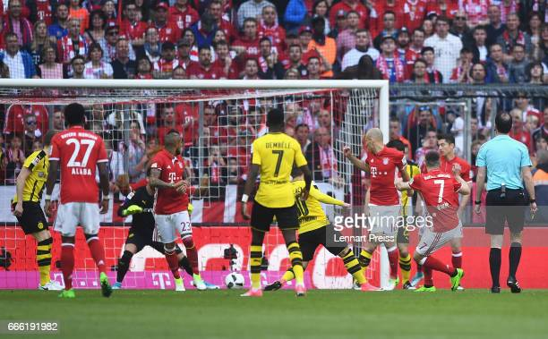 Franck Ribery of Bayern Muenchen scores his sides first goal during the Bundesliga match between Bayern Muenchen and Borussia Dortmund at Allianz...