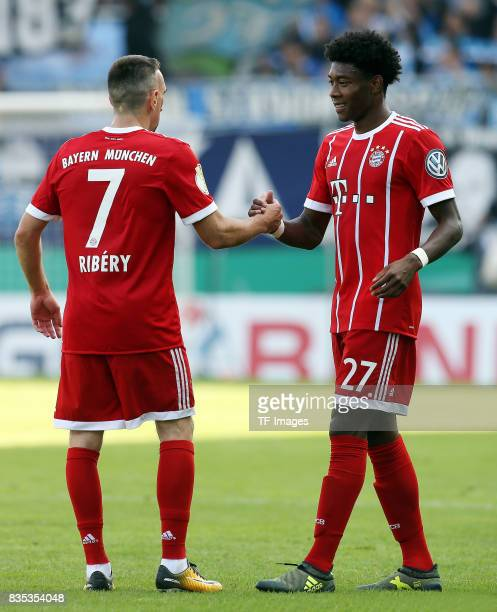 Franck Ribery of Bayern Muenchen shakes hands with David Alaba of Bayern Muenchen during the DFB Cup first round match between Chemnitzer FC and FC...