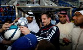 Franck Ribery of Bayern Muenchen sign autographs during the FC Bayern Muenchen training session at the Al Nasr training ground on January 7 2010 in...