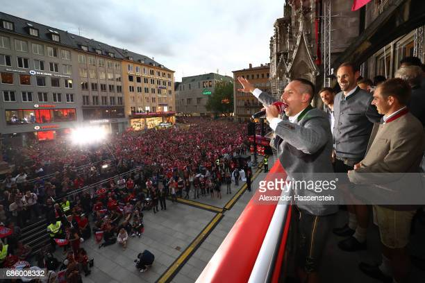 Franck Ribery of Bayern Muenchen speaks to the fans as they celebrate winning the 67th German Championship title on the town hall balcony at...