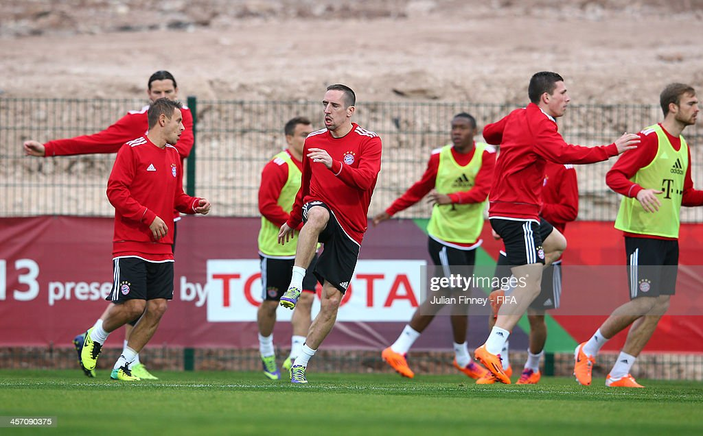 <a gi-track='captionPersonalityLinkClicked' href=/galleries/search?phrase=Franck+Ribery&family=editorial&specificpeople=490869 ng-click='$event.stopPropagation()'>Franck Ribery</a> of Bayern Muenchen warms up during a training session outside the Agadir Stadium on December 16, 2013 in Agadir, Morocco.