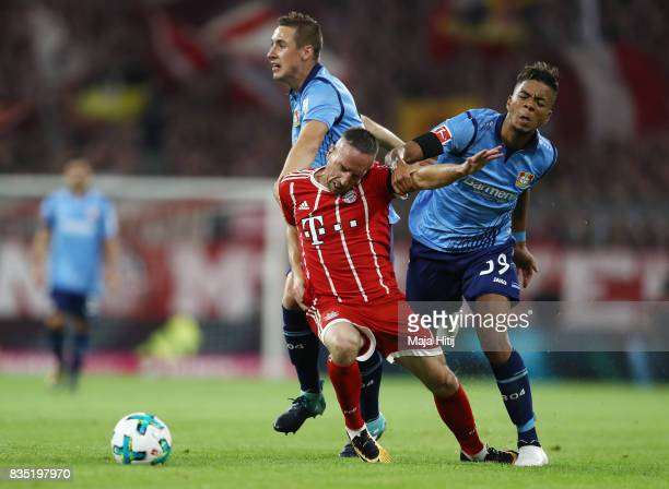 Franck Ribery of Bayern Muenchen with Benjamin Henrichs of Bayer Leverkusen and Dominik Kohr of Bayer Leverkusen during the Bundesliga match between...