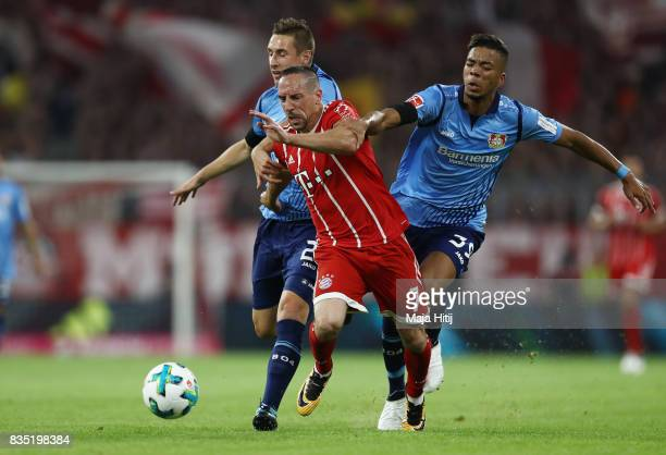 Franck Ribery of Bayern Muenchen with Benjamin Henrichs of Bayer Leverkusen during the Bundesliga match between FC Bayern Muenchen and Bayer 04...
