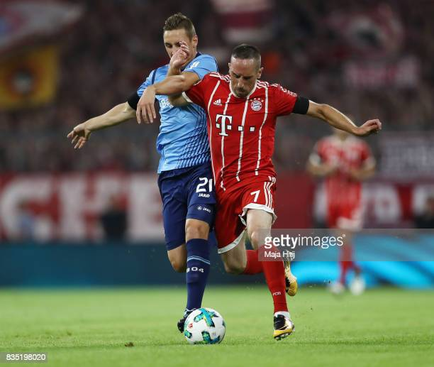 Franck Ribery of Bayern Muenchen with Dominik Kohr of Bayer Leverkusen during the Bundesliga match between FC Bayern Muenchen and Bayer 04 Leverkusen...