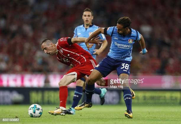 Franck Ribery of Bayern Muenchen with Karim Bellarabi of Bayer Leverkusen during the Bundesliga match between FC Bayern Muenchen and Bayer 04...