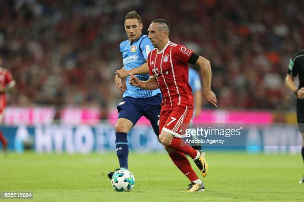 Franck Ribery of Bayern Munich and Dominik Kohr of Bayer 04 Leverkusen vie for the ball during the German First division Bundesliga soccer match...