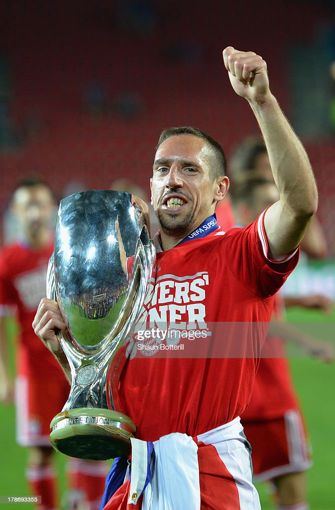 <a gi-track='captionPersonalityLinkClicked' href=/galleries/search?phrase=Franck+Ribery&family=editorial&specificpeople=490869 ng-click='$event.stopPropagation()'>Franck Ribery</a> of Bayern Munich celebrates with the trophy after victory during the UEFA Super Cup between Bayern Muenchen and Chelsea at Stadion Eden on August 30, 2013 in Prague, Czech Republic.