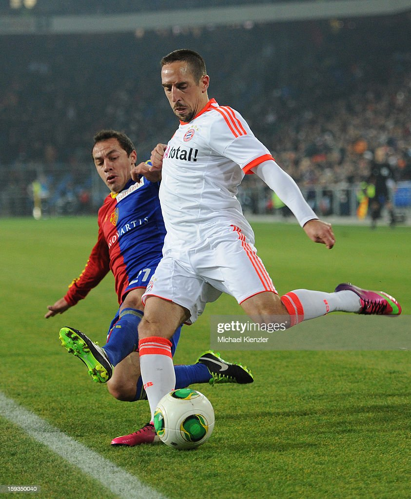 <a gi-track='captionPersonalityLinkClicked' href=/galleries/search?phrase=Franck+Ribery&family=editorial&specificpeople=490869 ng-click='$event.stopPropagation()'>Franck Ribery</a> of Bayern Munich (R) challenges Marcelo Diaz during the friendly match between FC Basel and Bayern Munich at Stadium St. Jakob on January 12, 2013 in Basel, Switzerland.