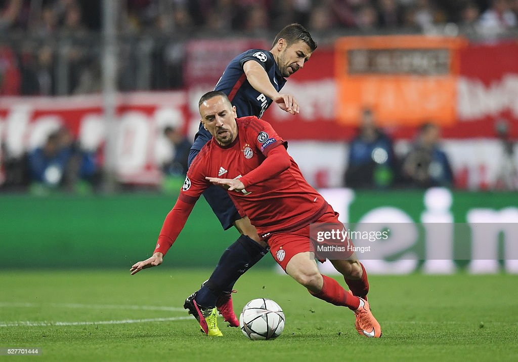 <a gi-track='captionPersonalityLinkClicked' href=/galleries/search?phrase=Franck+Ribery&family=editorial&specificpeople=490869 ng-click='$event.stopPropagation()'>Franck Ribery</a> of Bayern Munich evades <a gi-track='captionPersonalityLinkClicked' href=/galleries/search?phrase=Gabi+-+Voetballer&family=editorial&specificpeople=6912055 ng-click='$event.stopPropagation()'>Gabi</a> of Atletico Madrid during UEFA Champions League semi final second leg match between FC Bayern Muenchen and Club Atletico de Madrid at Allianz Arena on May 3, 2016 in Munich, Germany.