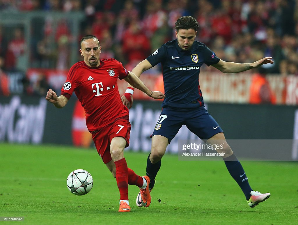 Franck Ribery of Bayern Munich evades Saul Niguez of Atletico Madrid during UEFA Champions League semi final second leg match between FC Bayern Muenchen and Club Atletico de Madrid at Allianz Arena on May 3, 2016 in Munich, Germany.