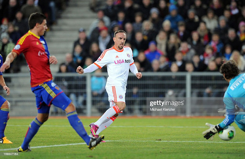 <a gi-track='captionPersonalityLinkClicked' href=/galleries/search?phrase=Franck+Ribery&family=editorial&specificpeople=490869 ng-click='$event.stopPropagation()'>Franck Ribery</a> (C) of Bayern Munich scores their third goal during the friendly match between FC Basel and Bayern Munich at Stadium St. Jakob on January 12, 2013 in Basel, Switzerland.