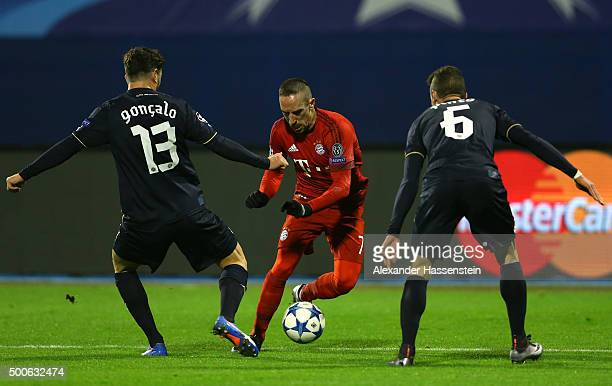 Franck Ribery of Bayern Munich takes on Goncalo Santos and Ivo Pinto of Dinamo Zagreb during the UEFA Champions League Group F match between GNK...