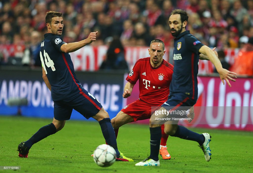 Franck Ribery of Bayern Munich (C) watches the ball with Gabi (L) and Juanfran of Atletico Madrid (R) during UEFA Champions League semi final second leg match between FC Bayern Muenchen and Club Atletico de Madrid at Allianz Arena on May 3, 2016 in Munich, Germany.