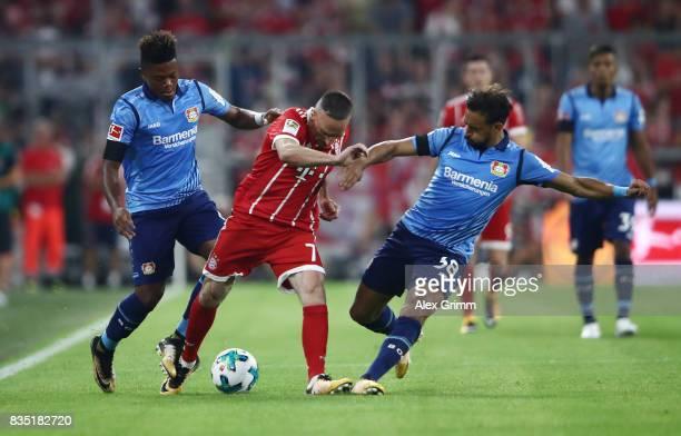 Franck Ribery of Bayern Munich with Leon Bailey of Bayer Leverkusen and Karim Bellarabi of Bayer Leverkusen during the Bundesliga match between FC...