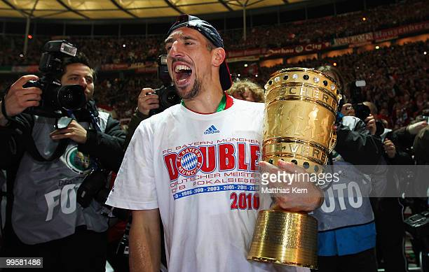 Franck Ribery of Bayern presents the trophy after winning the DFB Cup final match between SV Werder Bremen and FC Bayern Muenchen at Olympic Stadium...