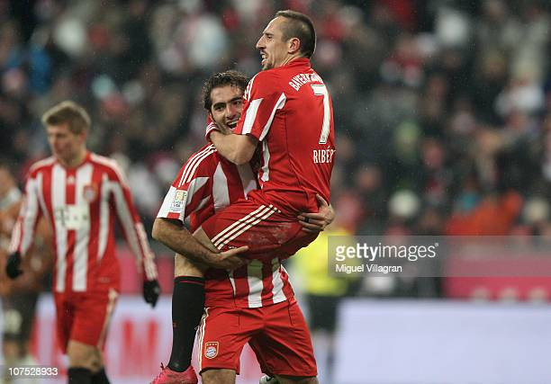 Franck Ribery of FC Bayern Muenchen celebrates his side's third goal with his team mate Hamit Altintop during the Bundesliga match between FC Bayern...