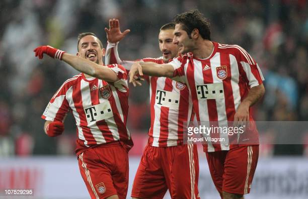 Franck Ribery of FC Bayern Muenchen celebrates his side's third goal with his team mates Diego Contento and Hamit Altintop during the Bundesliga...