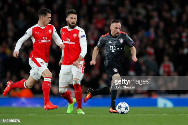 Franck Ribery of FC Bayern Muenchen is challenged by Granit Xhaka of Arsenal during the UEFA Champions League Round of 16 second leg match between...