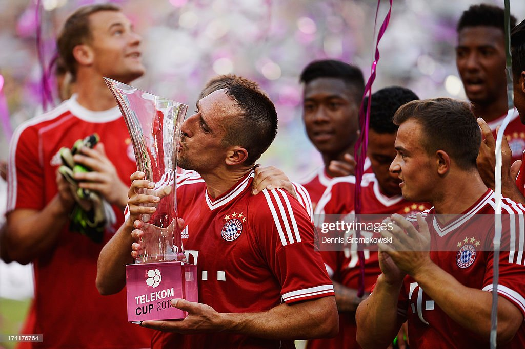 Franck Ribery of FC Bayern Muenchen kisses the trophy after the Telekom 2013 Cup final between FC Bayern Muenchen and Borussia Moenchengladbach on July 21, 2013 in Moenchengladbach, Germany.
