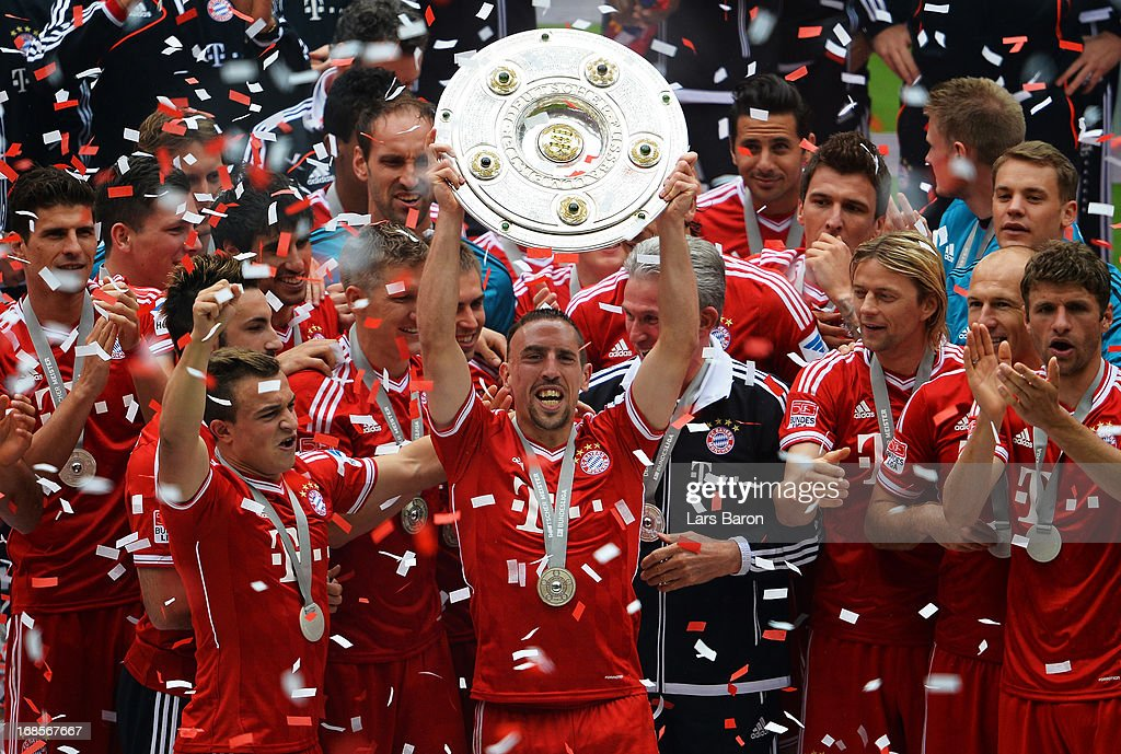 <a gi-track='captionPersonalityLinkClicked' href=/galleries/search?phrase=Franck+Ribery&family=editorial&specificpeople=490869 ng-click='$event.stopPropagation()'>Franck Ribery</a> of FC Bayern Muenchen lifts the Bundesliga trophy after the Bundesliga match between FC Bayern Muenchen and FC Augsburg at the Allianz Arena on May 11, 2013 in Munich, Germany.