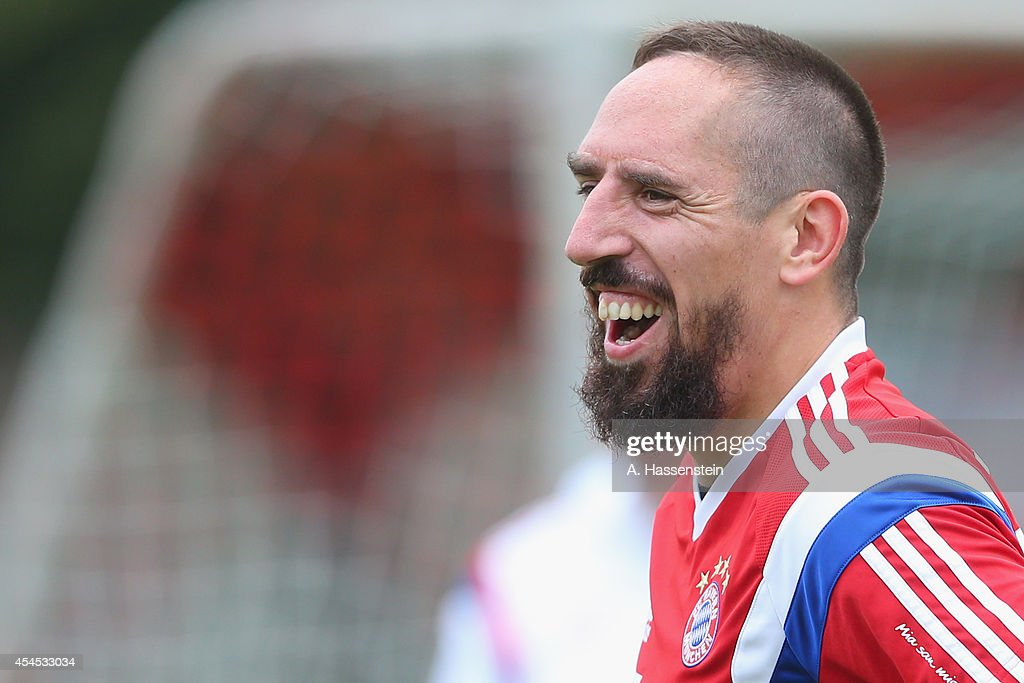 <a gi-track='captionPersonalityLinkClicked' href=/galleries/search?phrase=Franck+Ribery&family=editorial&specificpeople=490869 ng-click='$event.stopPropagation()'>Franck Ribery</a> of FC Bayern Muenchen smiles during a training session at Bayern Muenchen's trainings ground Saebener Strasse on on September 3, 2014 in Munich, Germany.