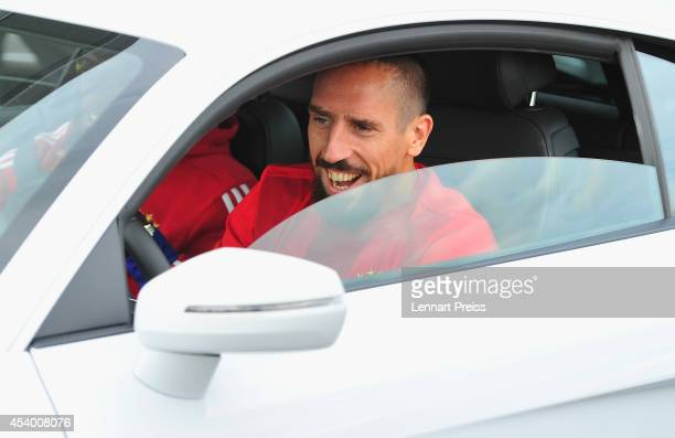 Franck Ribery of FC Bayern Muenchen waits for the start of a driving lesson during the car handover of Audi on August 23 2014 in Neuburg an der Donau...