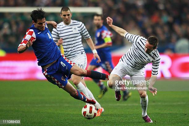 Franck Ribery of France and Dejan Lovren of Croatia battle for the ball during the International friendly match between France and Croatia at Stade...